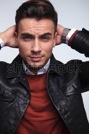 cool fashion man fixing his shirt's collar  Stock photo © feedough