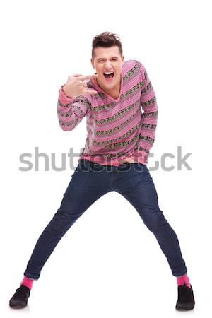 casual  man doing a rock and roll symbol Stock photo © feedough