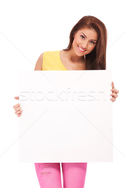 Attractive casual woman with blank poster  Stock photo © feedough