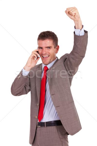 Podniecony człowiek biznesu telefonu młodych Zdjęcia stock © feedough