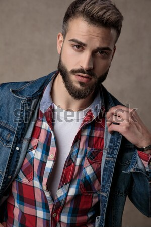 casual man with one brow reised Stock photo © feedough