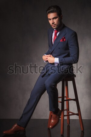 young man posing on a high chair Stock photo © feedough