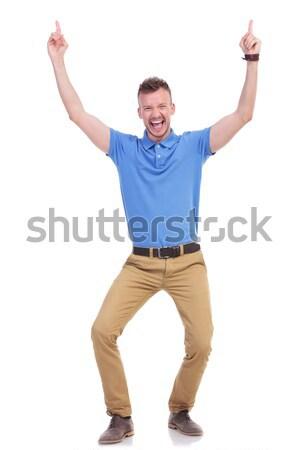 casual young man points upward Stock photo © feedough