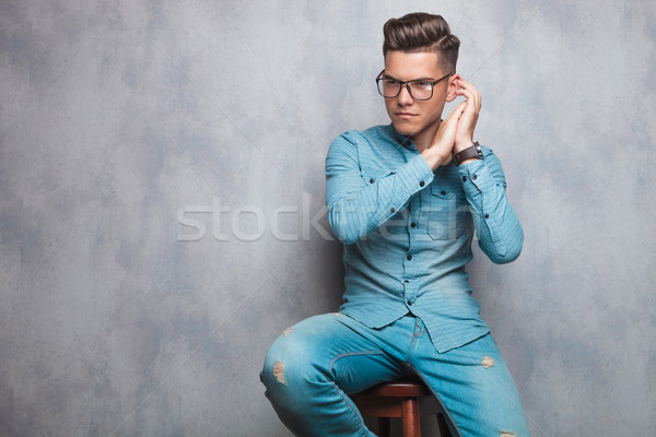 seated fashion man with palms together  Stock photo © feedough