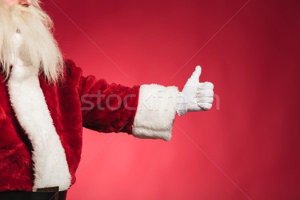 cut out side view of santa claus making ok Stock photo © feedough