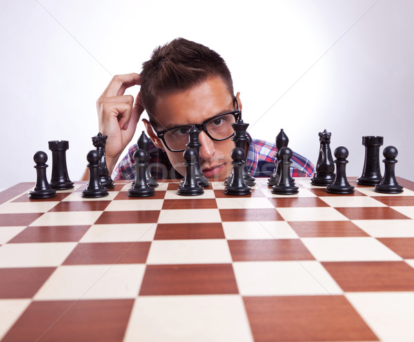 pensive man in front of his first chess move Stock photo © feedough