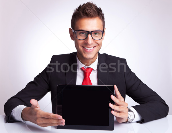business man presenting a touchscreen  pad Stock photo © feedough