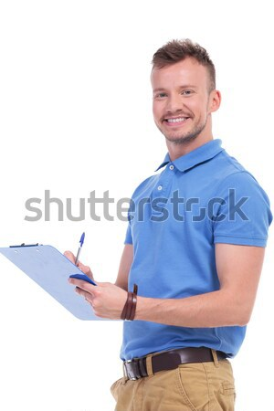 young casual man presenting or inviting Stock photo © feedough