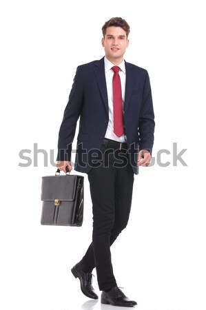 Side view of a young business man holding a brief case Stock photo © feedough