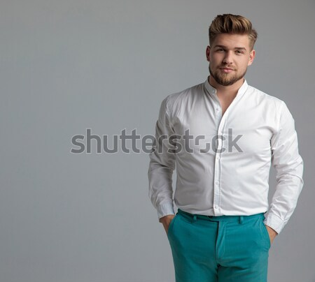 side view of a man leaning on wall and thinks  Stock photo © feedough