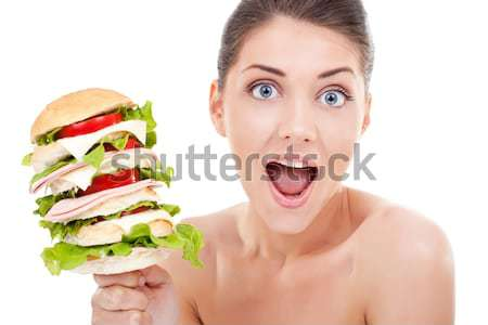 big sandwich in front of beautiful young woman Stock photo © feedough