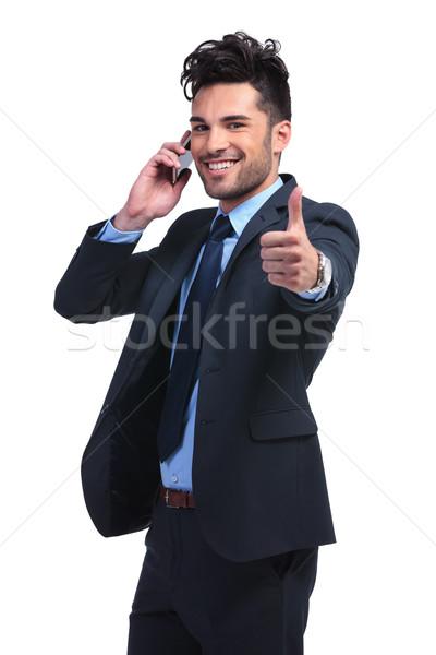Jeunes homme d'affaires bonnes nouvelles téléphone Photo stock © feedough