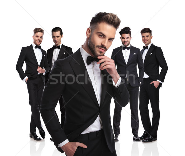 handsome groom with beard stands in front of group thinking Stock photo © feedough