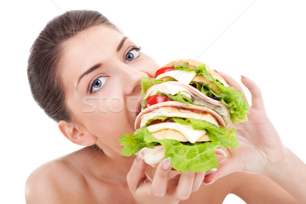 young woman eating fast food Stock photo © feedough