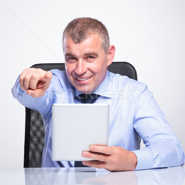 old business man at desk with pad pointing Stock photo © feedough