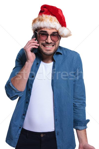 Święty mikołaj człowiek bad news telefonu tle smutne Zdjęcia stock © feedough