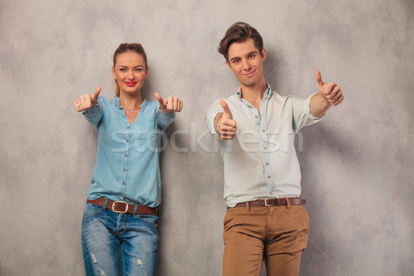 couple showing both thumbs up in studio background Stock photo © feedough