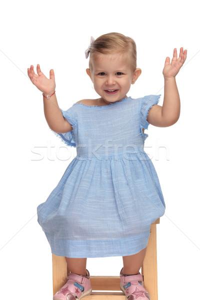 Izgatott kislány ül kezek levegő aranyos Stock fotó © feedough