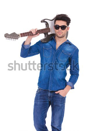 arrogant young man with guitar Stock photo © feedough