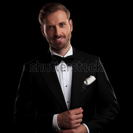 smiling young groom in tuxedo and bowtie  Stock photo © feedough