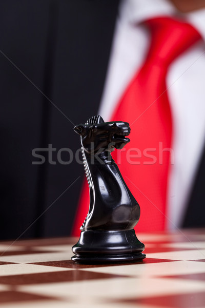 close-up picture of a black chess knight alone Stock photo © feedough
