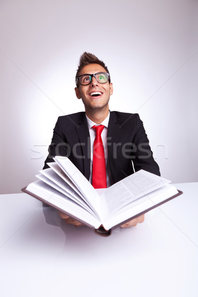 man opening a book with lots of knowledge wonders Stock photo © feedough