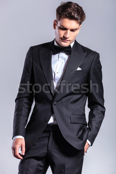 Attractive business man holding his hand in pocket  Stock photo © feedough