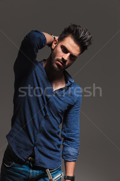 serious fashon man holding hand behind neck Stock photo © feedough