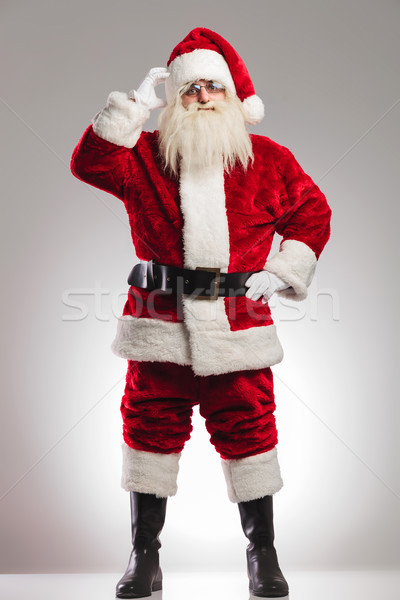 santa claus scratching his head and thinks  Stock photo © feedough