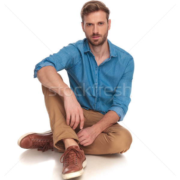 young casual man resting on the floor Stock photo © feedough