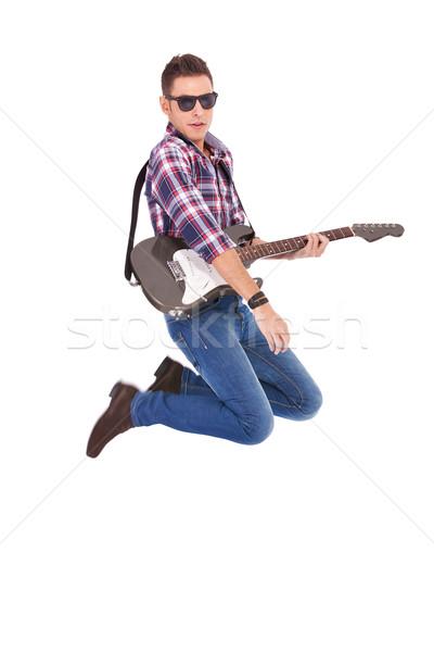 Appassionato chitarrista aria bianco casuale uomo Foto d'archivio © feedough