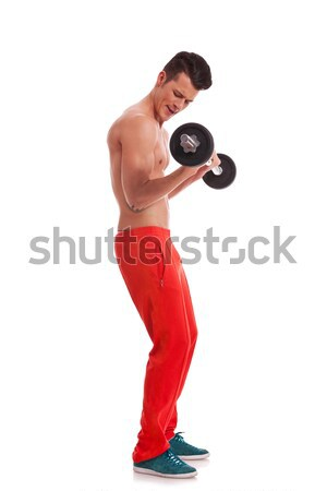 young man performing a bicep curl Stock photo © feedough