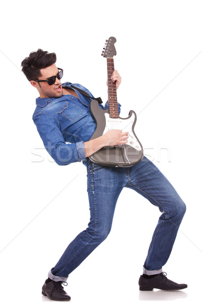 Stock photo: young guitarist performing