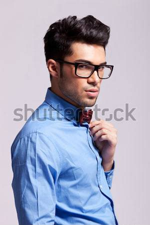 Young man with glasses thinking Stock photo © feedough