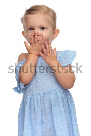 adorable little girl in blue dress is blowing a kiss  Stock photo © feedough
