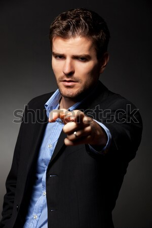 Angry businessman accusing  Stock photo © feedough