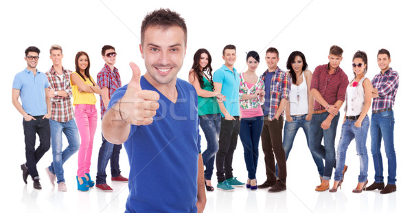 man making the ok thumbs up gesture in front of his firends Stock photo © feedough