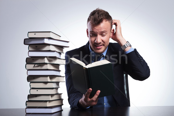 business man doesn't understand book Stock photo © feedough