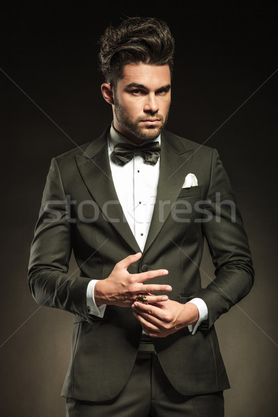 Elegant business man fixing his ring Stock photo © feedough