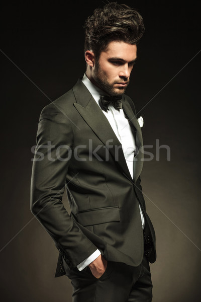 Stock photo: Elegant business man looking down and thinking.