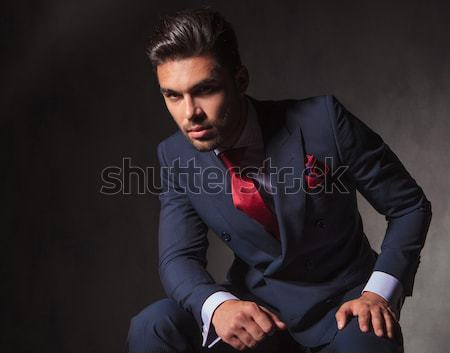 man leaning on a wall while sitting on the floor Stock photo © feedough