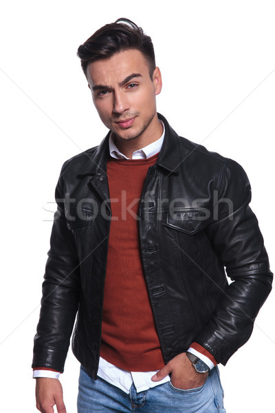 cool young man with hand in pocket  Stock photo © feedough