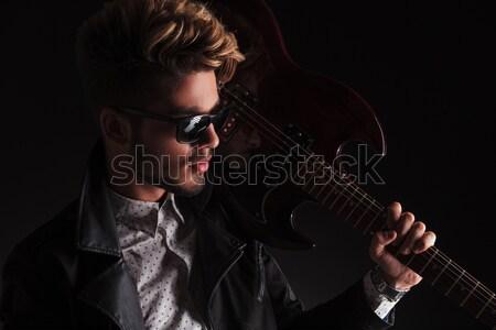 close up of fashion man with sunglasses smiling seductively Stock photo © feedough