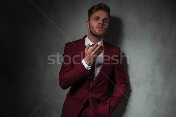 seductive man in grena suit sending an air kiss Stock photo © feedough