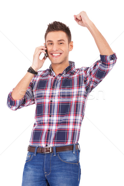 Stock photo:  happy young man receiving great news