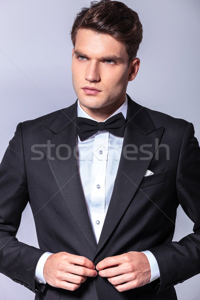 young elegant business closing his tuxedo Stock photo © feedough
