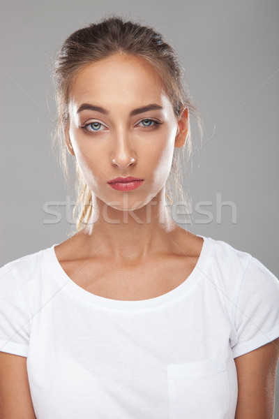 young beautiful woman with eyebrow raised is being suspicious Stock photo © feedough