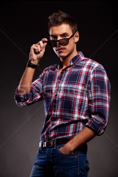 young casual man taking down his sunglasses Stock photo © feedough