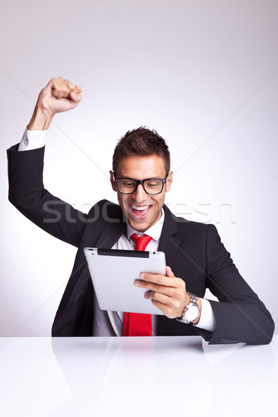screaming of joy while reading the good news on the tablet Stock photo © feedough