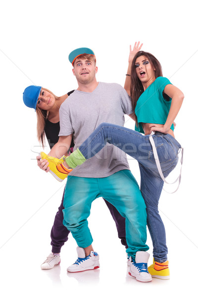 two women and a man fooling around Stock photo © feedough